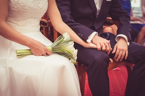 Couple on wedding day holding hands