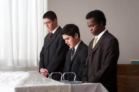 LDS Aaronic Priesthood preparing sacrament