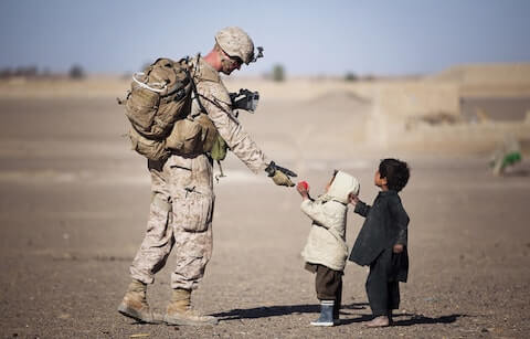 Picture of soldier with children