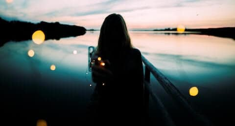woman looking at lake