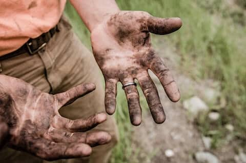 image of dirty hands from person working hard