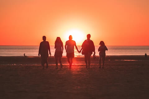 Family Walking into sunset (image depicting the worth of each human soul)